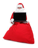 Santa claus shows laptop Royalty Free Stock Image