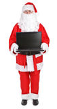 Santa claus shows laptop Royalty Free Stock Photo