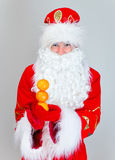 Santa Claus shows snowman. Royalty Free Stock Image