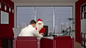 Santa Claus is sick, Doctor measuring blood pressure and giving bad news, stock footage Stock Photos