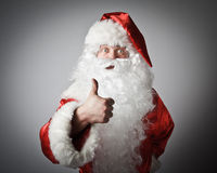 Santa Claus and sign of approval. Stock Photography