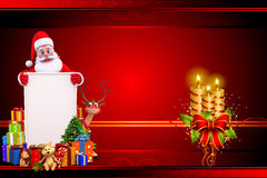 Santa claus with sign and golden candles Stock Photo