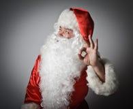 Santa Claus and sign of okay. Stock Photos