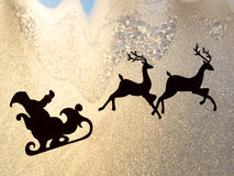Santa claus silhouette. On a frozen window Stock Photography