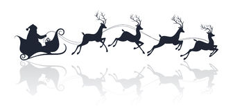 Santa Claus silhouette riding a sleigh with deers Royalty Free Stock Photography