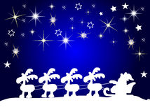 Santa claus silhouette with stars Stock Photos
