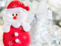 Santa claus and Silver bell,white silver bow and silver ball decoration on christmas. And new year background Royalty Free Stock Photography