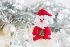 Santa claus and Silver bell,white silver bow and silver ball decoration on christmas Stock Photo