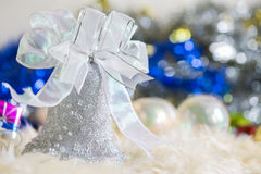 Santa claus and Silver bell,white silver bow and silver ball decoration on christmas Royalty Free Stock Photography