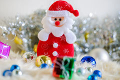 Santa claus and Silver colorful gift and blue green red gold ball decoration on chrismas. Colorful gift and blue green red gold ball decoration on chrismas Royalty Free Stock Photography