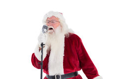 Santa Claus is singing Christmas songs Stock Images