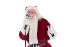 Santa Claus is singing Christmas songs Stock Image