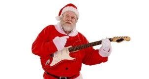 Santa claus singing a song and playing guitar