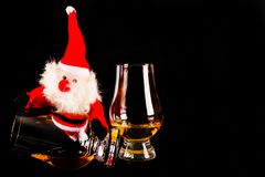 Santa Claus with single malt whiskey glass, Symbol of Christmas. Holiday, Xmas set, decoration Royalty Free Stock Photos