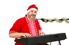 Santa Claus sings Xmas song. Man in Santa Claus suit sings Xmas song Stock Photos