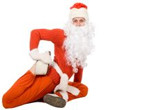 Santa Claus sit on half twine and stretching Royalty Free Stock Images