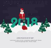 Santa Claus sits on the inscription 2018. Royalty Free Stock Images