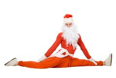 Santa Claus sits on a splits. Isolated on the white background Royalty Free Stock Photo