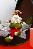 Santa Claus sits on vintage brouwn coffer with white christmas t Stock Photography