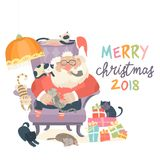 Santa Claus sitting in armchair with cats Royalty Free Stock Photo