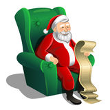 Santa Claus sitting in armchair and reading Christmas letter Royalty Free Stock Photos