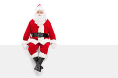 Santa Claus sitting on a blank billboard Royalty Free Stock Images