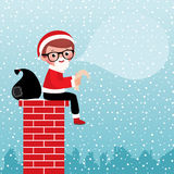 Santa Claus sitting on a chimney Stock Photos