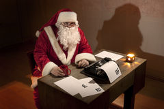 Santa Claus sitting by a desk Royalty Free Stock Photos