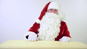 Santa Claus sitting and gestures stock video footage