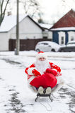 Santa Claus sitting in his sleigh on a city street during the Christmas holiday stock images