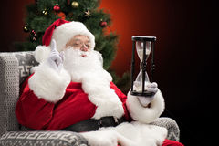 Santa Claus sitting with hourglass Stock Photo
