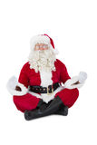 Santa claus sitting in lotus pose Stock Images