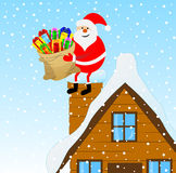 Santa Claus sitting on a pipe of a wooden house with a bag of gi Royalty Free Stock Photo