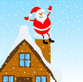 Santa Claus sitting on a pipe of a wooden house Stock Images
