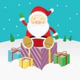 Santa Claus  sitting on a present. Santa Claus is waving his hand among the presents Royalty Free Stock Photos