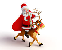 Santa Claus sitting on the reindeer Royalty Free Stock Images