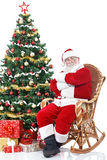 Santa Claus sitting in rocking chair Stock Photos