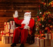 Santa Claus sitting on rocking chair Stock Photography