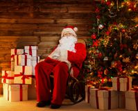 Santa Claus sitting on rocking chair Stock Images