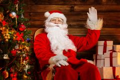 Santa Claus sitting on rocking chair Stock Photo