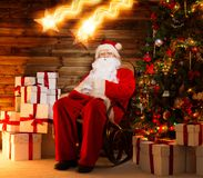Santa Claus sitting on rocking chair Royalty Free Stock Photo