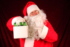 Santa Claus with Six Pack of Beer Royalty Free Stock Photos