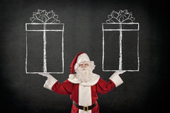 Santa Claus with Sketched Gift Boxes Stock Photos