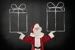 Santa Claus with Sketched Gift Boxes Royalty Free Stock Photos