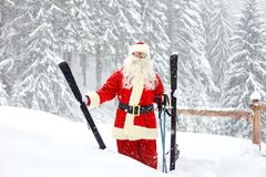 Santa Claus skier on the background of the ski landscape. Royalty Free Stock Photo