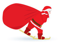 Santa Claus skiing with sack Royalty Free Stock Images