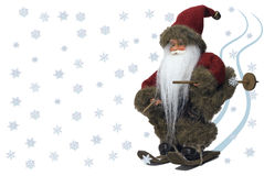 Santa Claus skiing with snow stock photography