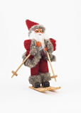 Santa Claus on skis tree a toy isolated Royalty Free Stock Photos