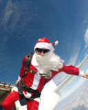 Santa Claus Skydiver jump from the plane. Radical Santa practicing extreme sports Stock Photography