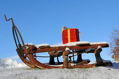 A Santa Claus sled with a red gift Stock Images